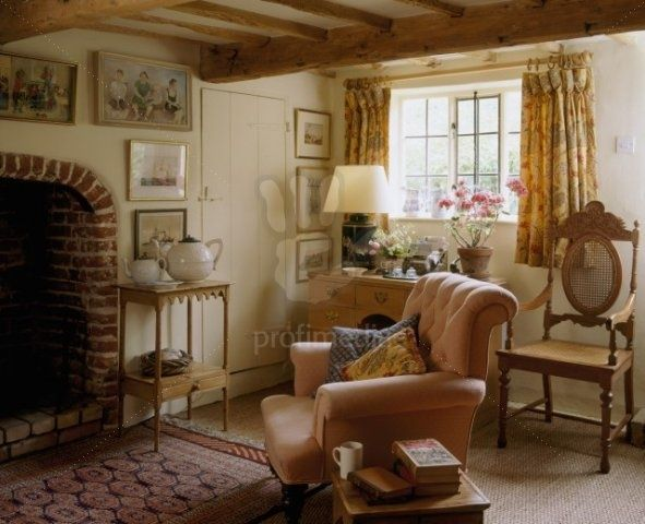 A Country Cottage Sitting Room With Beamed Ceiling And