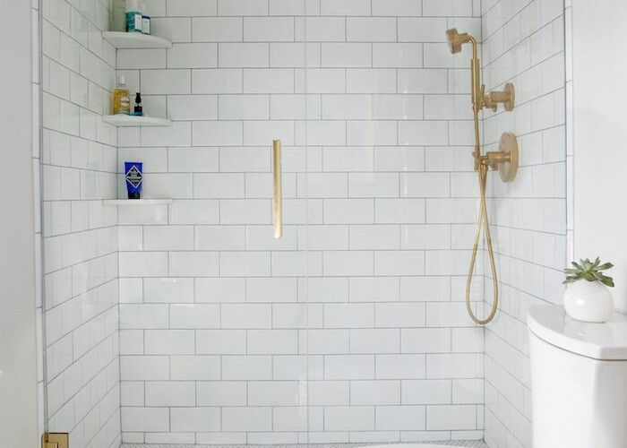 beautiful bathroom with marble herringbone floors white tile dark grout and brass hardware would maybe do silver for resale purposes also pin by megan haughery on washrooms pinterest bath future house
