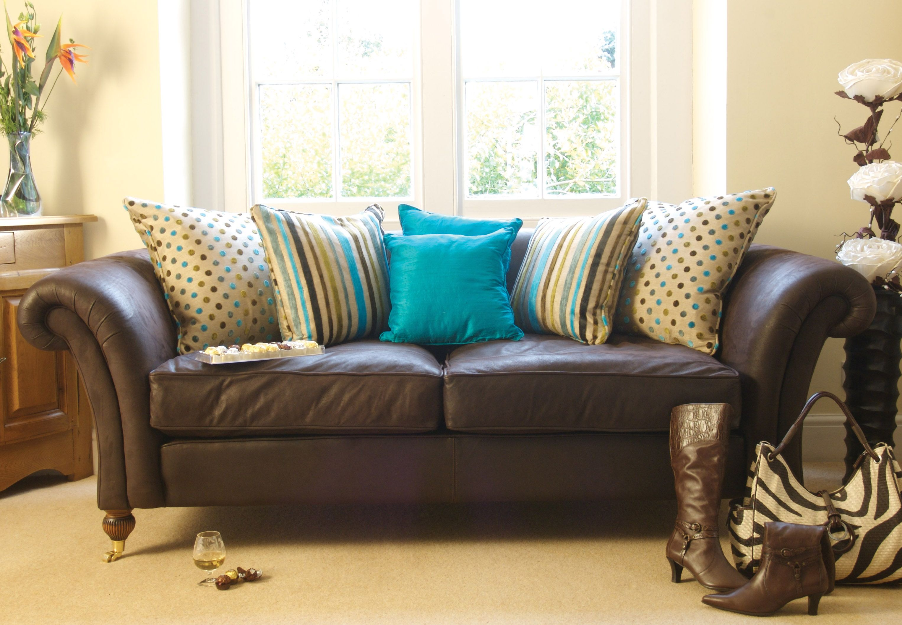 bright colored sofa pillows custom made sofas uk turquoise on brown for my home pinterest