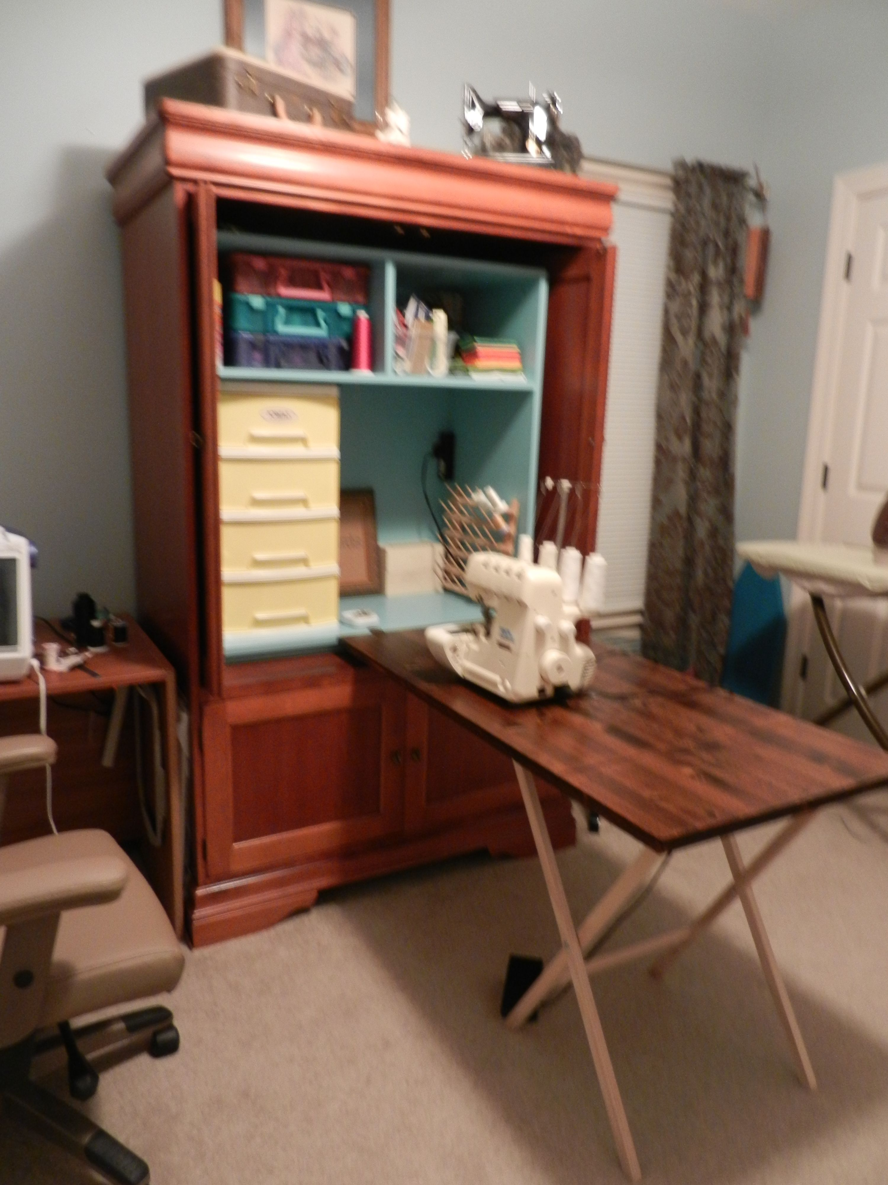 My repurposed entertainment center Sewing armoire Added
