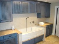 Neat idea - blue painted craftsman cupboards, tub like a ...