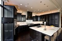 Picture of Dark Kitchen Cabinet with White Countertop