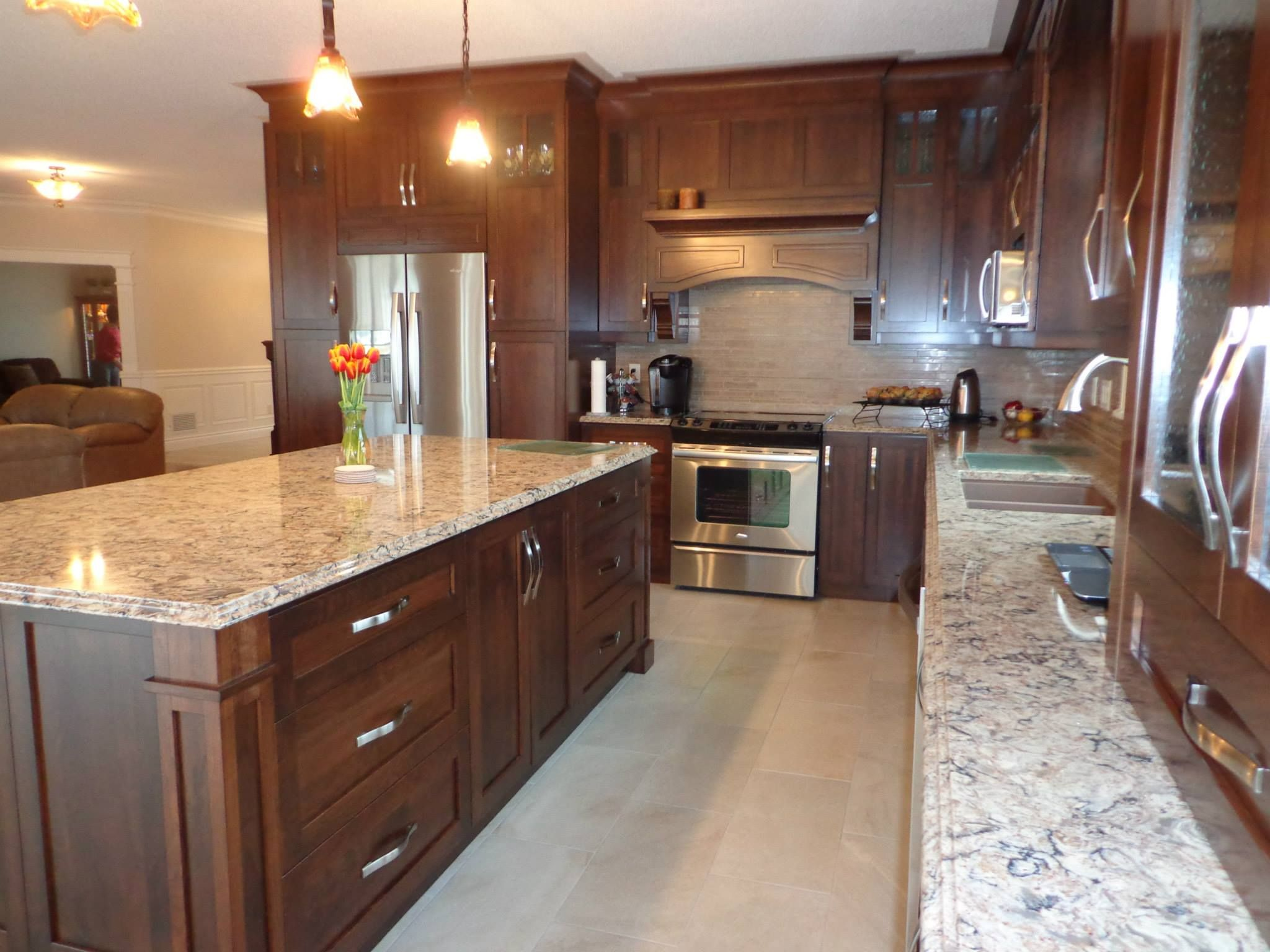 kitchen cabinets light wood high end sinks stained cherry with colored quartz