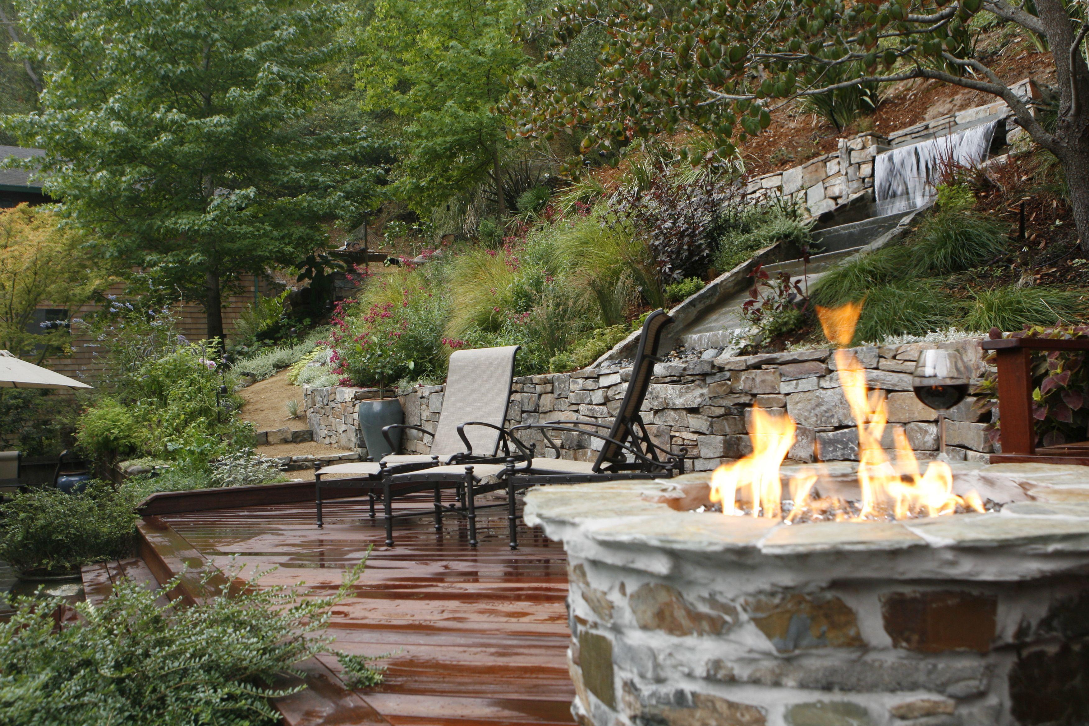 Backyard Waterfall Sloping Backyard Fire Pits And Backyard