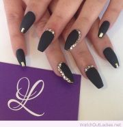 matte black nails with golden accents