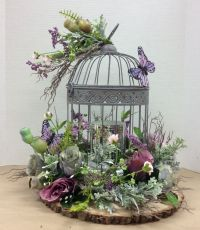 Floral design I made using wire bird cage glued to foam ...
