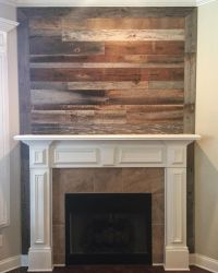 fireplace with reclaimed wood above