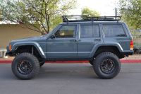 Great looking XJ with roof rack and flush lights.