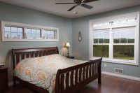 Bedroom 1. 9' Tall ceiling and an awning windows above the ...
