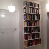 Ikea algot floating bookcases keeps floor space clear for