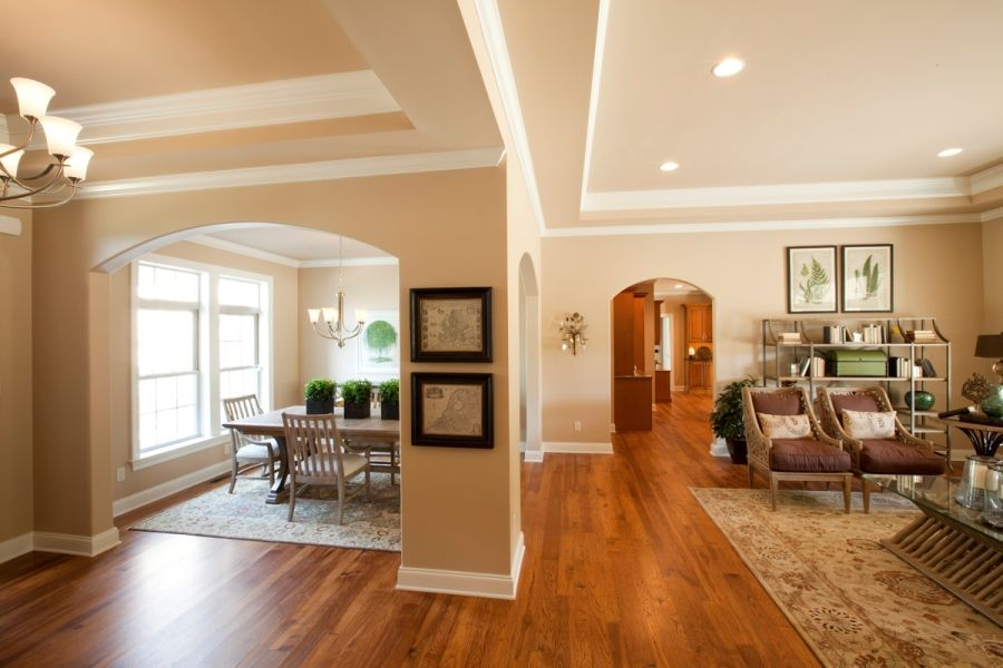 Open foyer, living room, and dining room, separated by