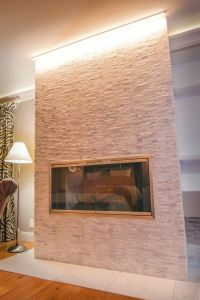 A great way to accent a fireplace is by using LED strip ...