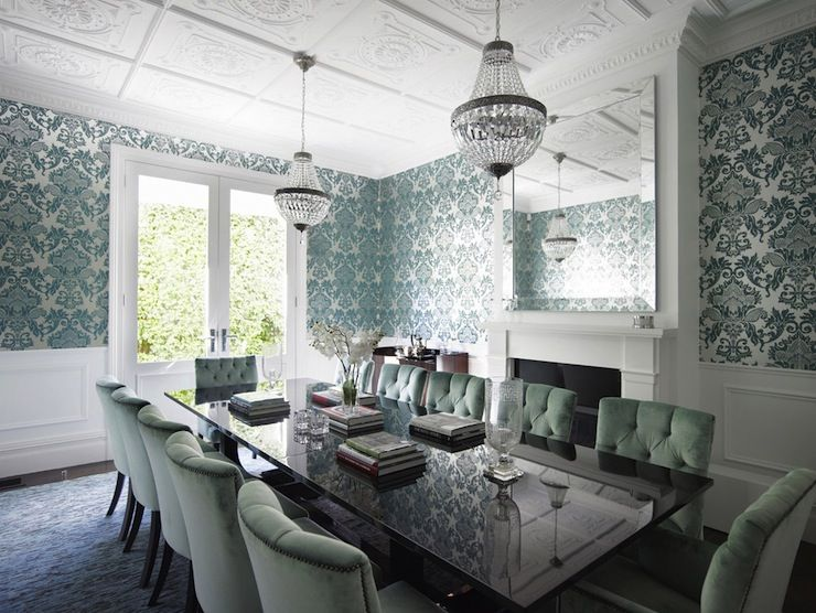 Incredible dining room with teal damask wallpaper over