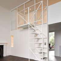 "Wireframe staircase leads to mezzanine sleeping ""nest"" in ..."