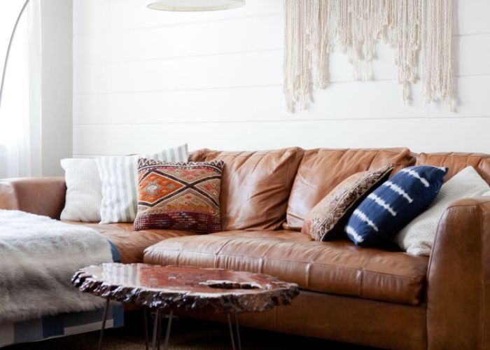 Dark leather couch macrame wall hanging white oversized lamp persian blue and purple boho rug wood coffee table also img home is where the pinterest
