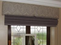 Upholstered pelmet with Roman blind. We used a tiny Houles ...