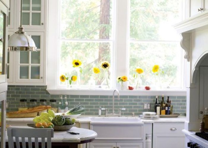Flowers on the window aqua glass subway tile backsplash white cabinets slate floor also light fixture home bound pinterest tiles kitchen