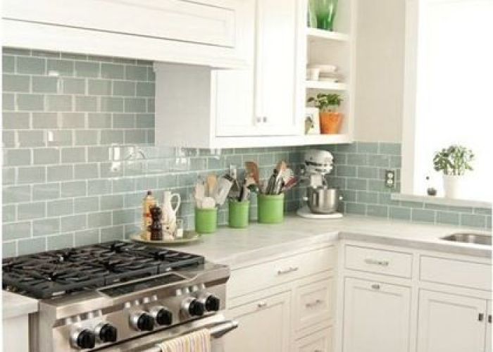 Kitchen remodel blue glass tile backsplash love the back splash and tithe white cabinets also  dream of marble counters green