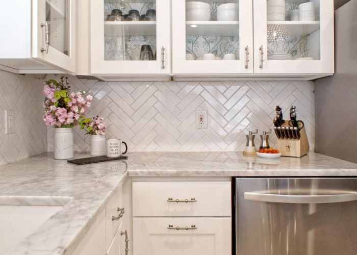 This light and bright modern kitchen combines white gray tones to create  lively area of the home glass front cabinets are mixed in with shaker also ro