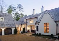 Love the stucco, windows, and carriage doors. Looks modern ...