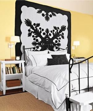 Decorating tricks for your bedroom diy artwork hanging  graphic quilt is an easy solution to the  cbig blank wall   issue complementary bed linens pull also this pin nice way decorate room yellow and rh pinterest