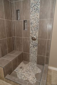 Spruce up your shower by adding pebble tile accents! Click ...