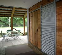 Framed corrugated steel barn door. | Exterior: Detail ...