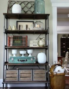 White pumpkins pop amidst  well curated collection of rustic pieces like weathered crates and muted feathers in kelly   home also take peek inside our favorite bloggers homes accents rh pinterest