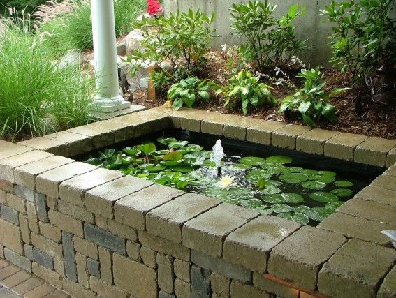Raised Koi Pond By Signature Outdoor Concepts Waterfalls Ponds