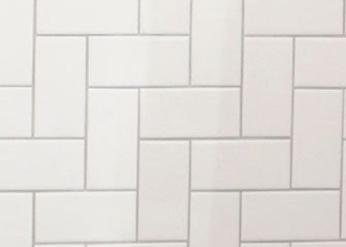 Basic is beautiful call attention to your decorative tile pattern by accenting simple white with in  slightly darker grout colour also green glass blends hakatai tiles and