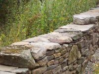 dry stack rock wall for the front circle garden?