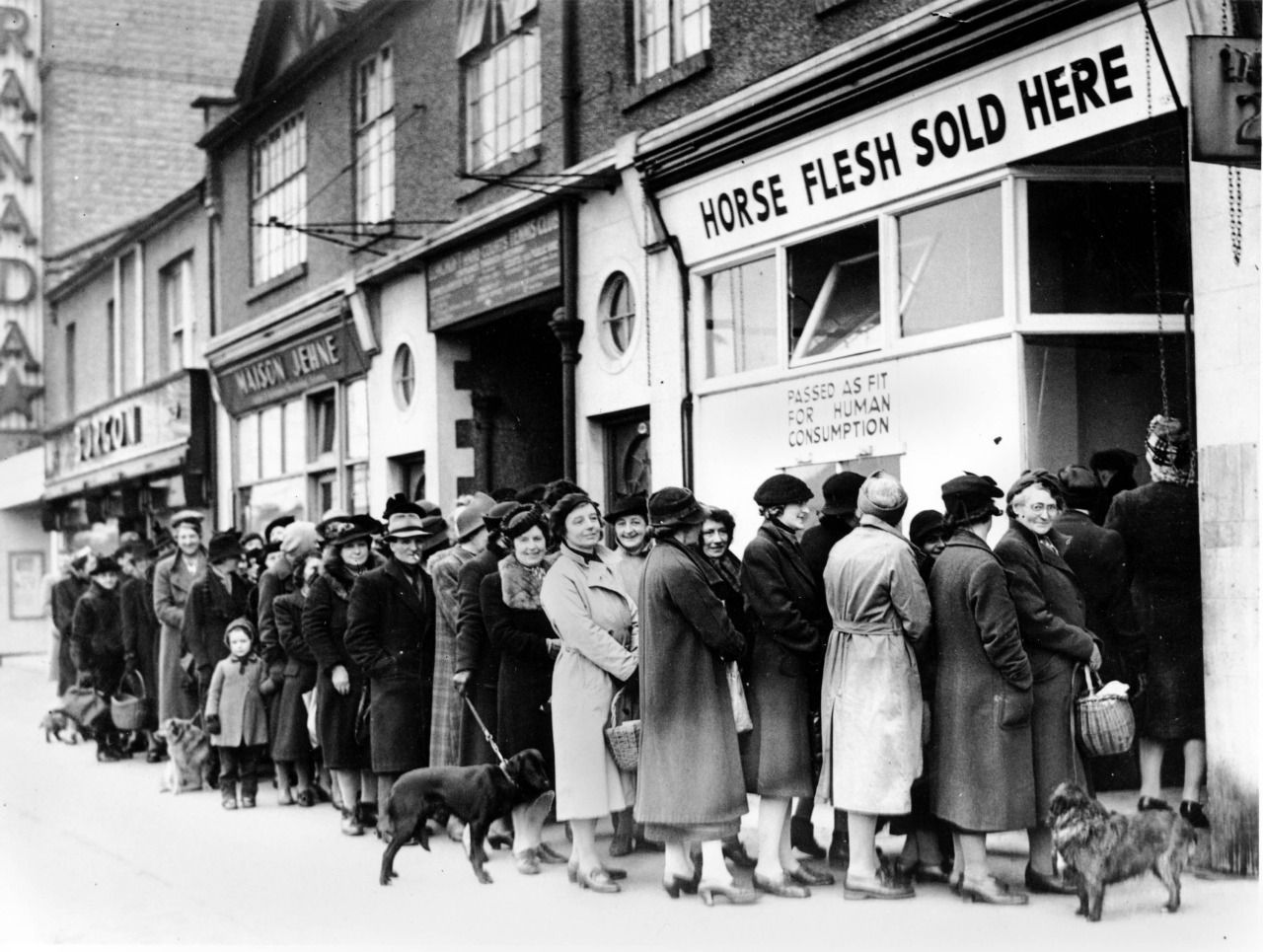 Women Line Up Outside A Butcher Shop In North Cheam