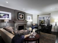 This living room features a dark gray accent wall situated ...