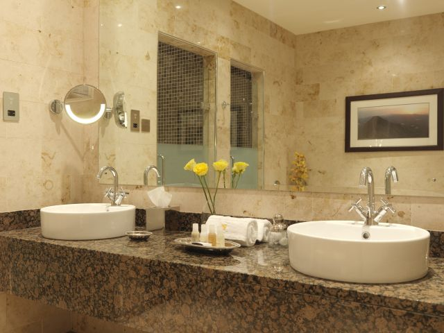 Classy Double White Round Bowl Sink Brown Granite Countertop