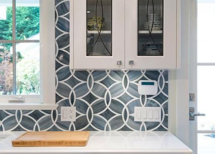 White and blue kitchen boasts shaker cabinets painted benjamin moore heron paired with princess also