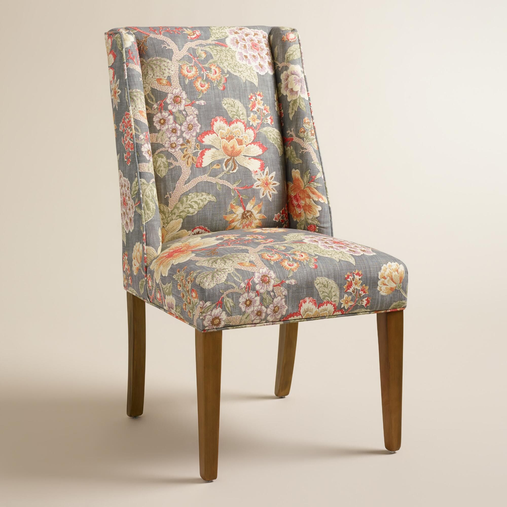 Floral Wingback Chair With A Warm Hued Floral Motif And Subtle Wingback Profile