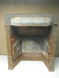 vintage antique cast iron fireplace insert by Buckeye