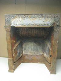 vintage antique cast iron fireplace insert by Buckeye