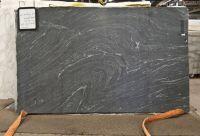 Honed black granite with white veins! looks like soapstone ...