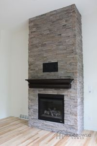 This beautiful floor to ceiling fireplace is at our ...