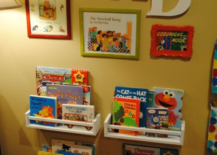Cute little book nook reading center for kid   bedroom or playroom just frame favorite covers hang letters to spell out read and add low shelves also corner kiddos pinterest playrooms room