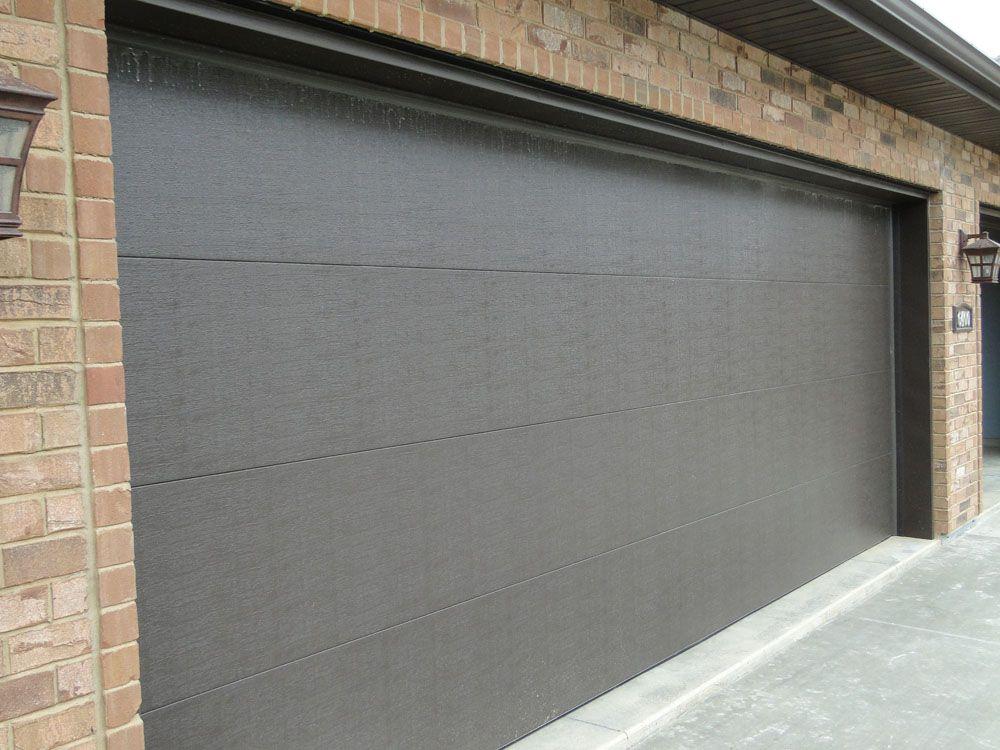 CONTEMPORARY FLAT PANEL garagedoors  Custom Homes by