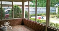 [screened in] porch enclosure with existing brick knee