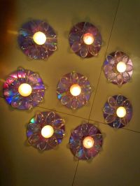 Beautiful candle holders created made out of old CD's ...