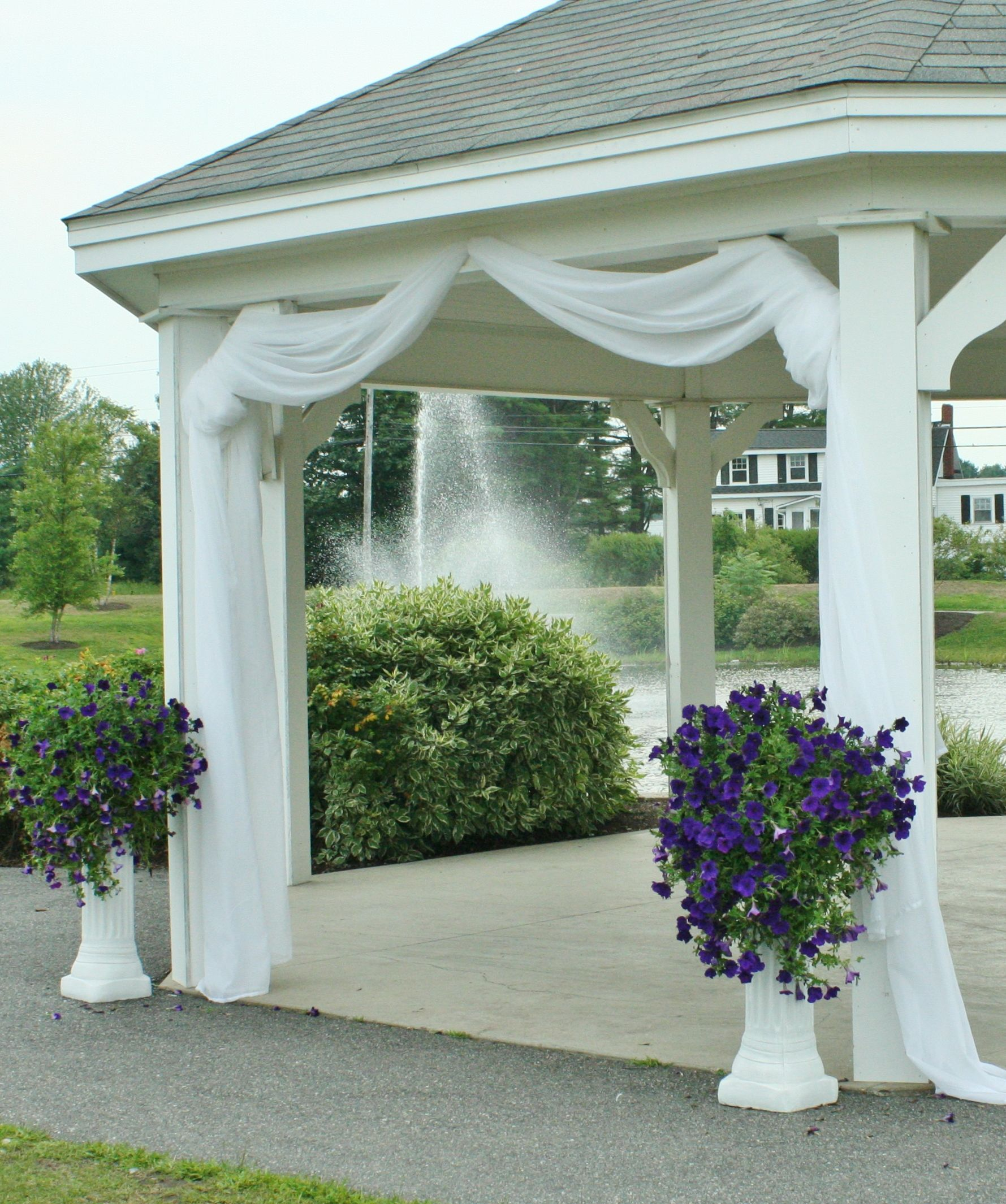 Use fabrictulle to decorate gazebo  maybe just at the entrance and not all the way around