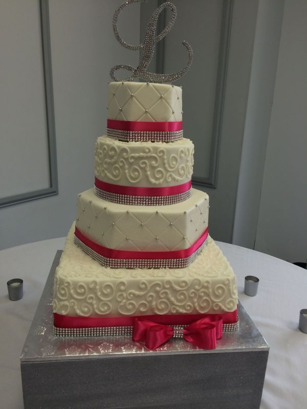 Four Tier Wedding Cake With Square Hexagon And