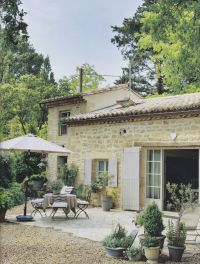 Rustic French country home with stone exterior, light gray ...