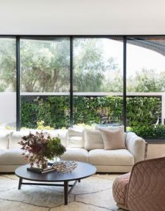 This living room has  large wall of windows that lead out to private outdoor also rh pinterest