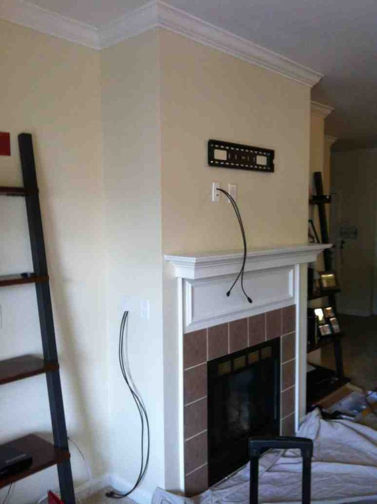 Concealing wires in the wall over the fireplace before the
