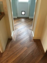 Karndean wood laid to kitchen and utility with border and ...